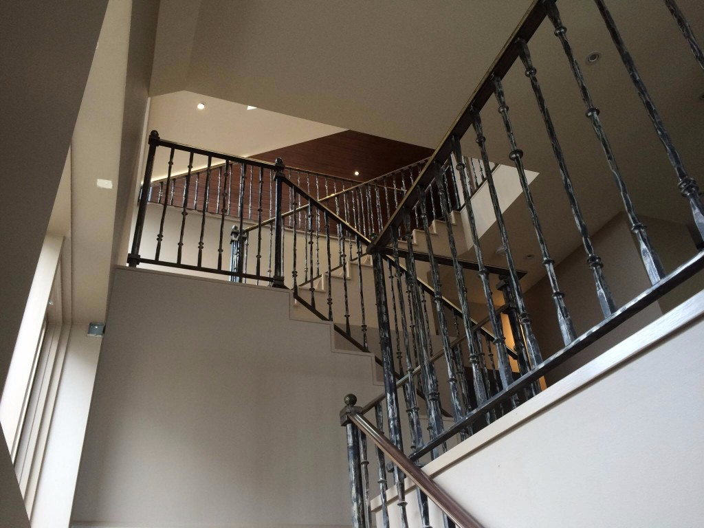 Staircase with brass handrail three