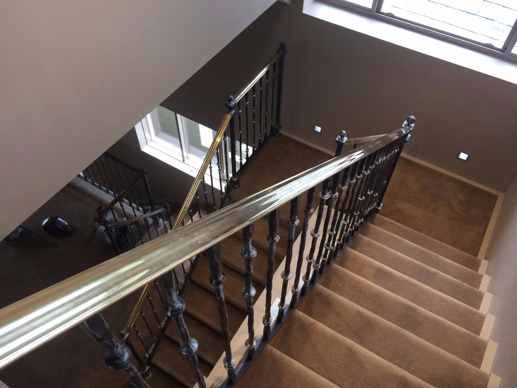 Staircase with brass handrails one